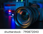 Small photo of Photo Camera or Video lens close-up on black background DSLR objective