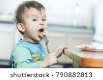 a hungry child is eating... | Shutterstock . vector #790882813
