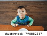 a hungry child is eating... | Shutterstock . vector #790882867