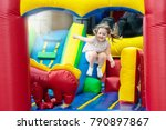Child Jumping On Colorful...