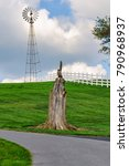 Small photo of Wooden sculpture and windmill in Amish Country in Pennsylvania, USA