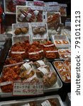 Small photo of Otaru, JAPAN - DEC 2017 :variety of Fresh sea shell, scallop,seafood stall.Hokkaido giant crab,Alaska king crab is selling in Sapporo Hokkaido.