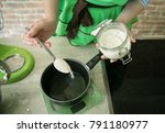 a confectioner in a green apron ... | Shutterstock . vector #791180977