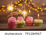 cupcake with sparkler on old... | Shutterstock . vector #791184967