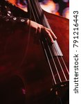 Small photo of View of musician playing contrabass. Musical Instrument