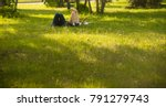 young couple in a park lie on... | Shutterstock . vector #791279743