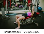 girl lying on a simulator lifts ... | Shutterstock . vector #791283523