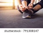 woman tying running shoes on... | Shutterstock . vector #791308147