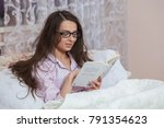 young woman wearing glasses... | Shutterstock . vector #791354623