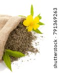 Small photo of Damiana dried leaves in burlap bag with damiana flower. Isolated on white background.