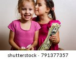 two girls counting their money | Shutterstock . vector #791377357