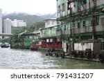 Small photo of Hong Kong - June 2008: The shoddy back of Jumbo Floating Restaurant in Aberdeen Harbor