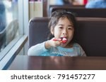 asian little cute girl eat the... | Shutterstock . vector #791457277
