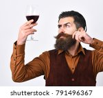 man with beard holds alcohol on ... | Shutterstock . vector #791496367