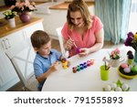 happy young mother and son are... | Shutterstock . vector #791555893