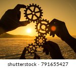 four hands collect the gear...   Shutterstock . vector #791655427