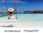 happy female traveller is... | Shutterstock . vector #791663707