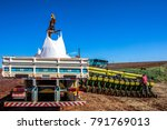 Small photo of Rolandia PR, Brazil, February 28, 2013. Worker carry an agricultural machine with fertilizer to be used along with corn planting in Rolandia, northern region of Parana State.