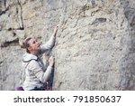 the girl climbs the rock.... | Shutterstock . vector #791850637