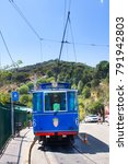 Small photo of BARCELONA - July 13, 2016: Nostalgic Blue Tram to Tibidabo. Inaugurated in 1901, still uses same streetcars, thus being one of oldest trams in world.