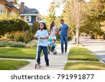 couple push daughter in... | Shutterstock . vector #791991877