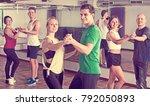 young men and women dancing a... | Shutterstock . vector #792050893