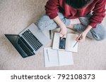 overhead view of young brunette ...   Shutterstock . vector #792108373