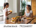mother and daughter having... | Shutterstock . vector #792166057