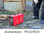 welder makes a fence in the... | Shutterstock . vector #792219523