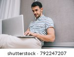 handsome smiling young...   Shutterstock . vector #792247207