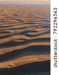 ripple textures in the sand at... | Shutterstock . vector #792296563