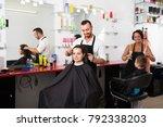joyful man hairdresser making... | Shutterstock . vector #792338203