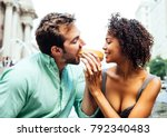 happy couple eating hot dogs... | Shutterstock . vector #792340483