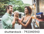happy couple eating hot dogs... | Shutterstock . vector #792340543