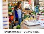 caucasian woman buying... | Shutterstock . vector #792494503