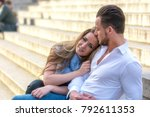 Small photo of Woman lovingly clings to the strong shoulder of her partner