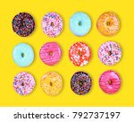 doughnuts on a yellow... | Shutterstock . vector #792737197