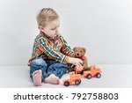 small boy is playing with toys | Shutterstock . vector #792758803