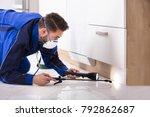 man spraying pesticide under... | Shutterstock . vector #792862687