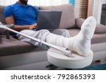 man with broken leg sitting on...   Shutterstock . vector #792865393