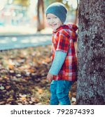 child walking in the park. | Shutterstock . vector #792874393