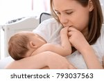 mother holding sleeping newborn ... | Shutterstock . vector #793037563