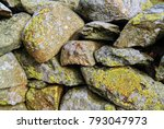 Small photo of Dry Stone Walling technique used in the English Lake District of Cumbria. A mixture of small and large stones stabilises the wall. These techniques have been learnt over centuries of experiment.