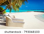 rattan sun loungers on maldives ... | Shutterstock . vector #793068103