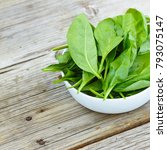 baby spinach in a white bowl on ...   Shutterstock . vector #793075147