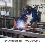 man welds steel construction | Shutterstock . vector #793089247