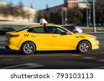 Yellow Taxi Cab In Motion On A...