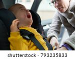 unhappy baby boy crying in car... | Shutterstock . vector #793235833