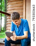 happy young man with a tablet... | Shutterstock . vector #793303663