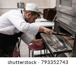 cheff cooking pizza and putting ... | Shutterstock . vector #793352743